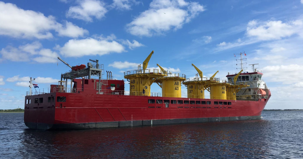 Ship transporting windmill components for renewable energy