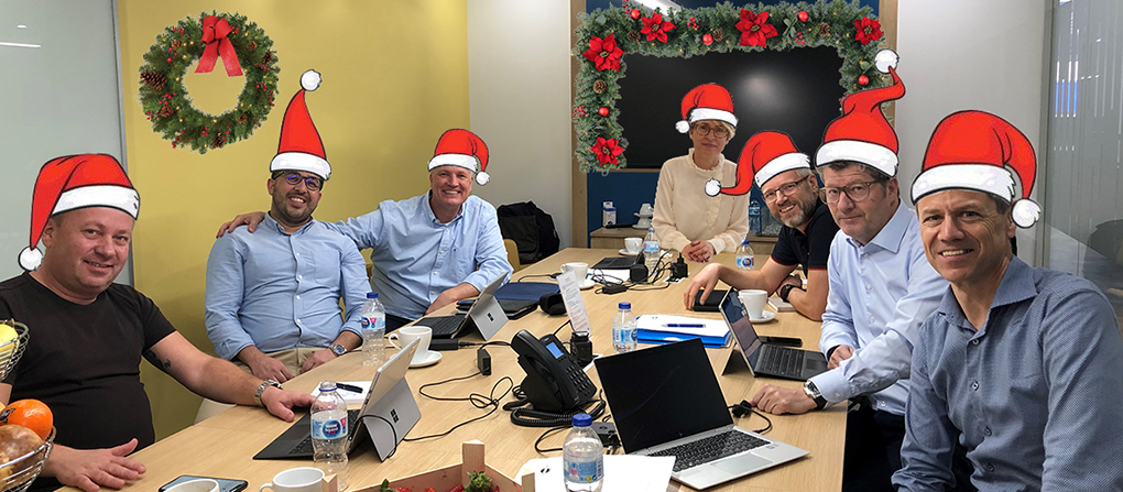 Board of Martin Bencher Group wearing christmas hats